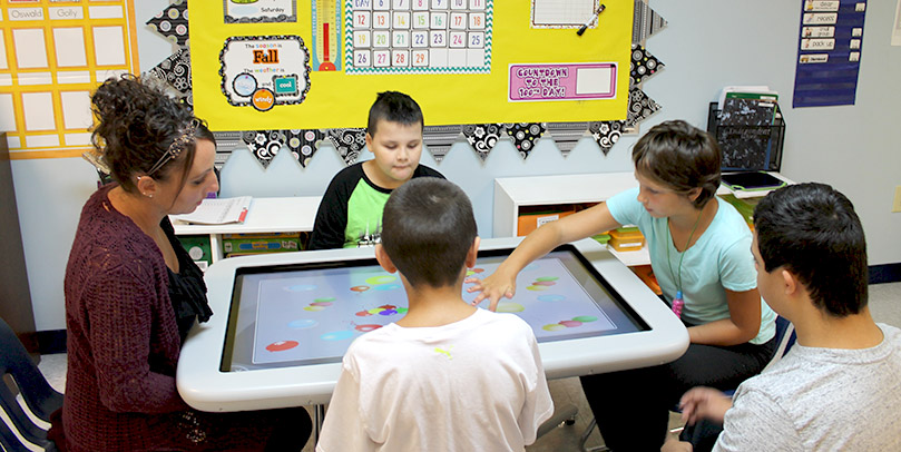 Students working at Smart Table - private special education school - New Roads School, Parlin, Somerset and Lakewood NJ
