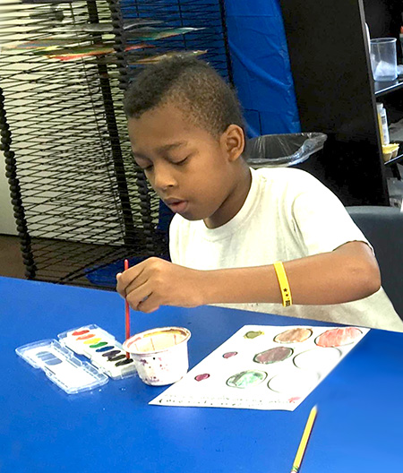 African American male student in art class - private special education school in NJ